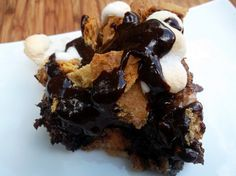 smores bread pudding made with a rich custard made with sweet condensed milk and a little cinnamon and filled with mini marshmallows, chocolate chips, and graham cracker squares