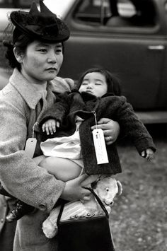 Mother and Child of Japanese Descent Leaving Bainbridge Island for Relocation Camp~WWII- Let us not forget the injustice done to our Japanese citizens who were put into camps in the US and had their property and lives stolen from them. What happened to them was wrong.