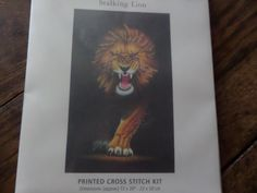 """Cross stitch kit """"Stalking Lion"""" printed canvas by MaddisonsRainbow on Etsy Lion Print, Vibrant Colors, Colours, Cross Stitch Kits, Chart, Canvas Prints, Printed, Etsy, Vivid Colors"""