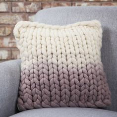 Chunky hand-knitted decorative cushion, dip-dyed in mauve and cream.
