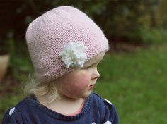 PDF knitting pattern for a hat with flower. It has instructions for 6 sizes from newborn up to child (5T+) and has both knitting in the round instructions AND knit flat on two needle instructions. Its simple and cute, and looks just as good on a newborn as it does a child so you could knit matching hats for a new arrival and their older sister. The flower looks intricate but is incredibly simple to knit and there are stage by stage photos to guide you YARN: 26 - 48 grams (52 - 96 metres)…