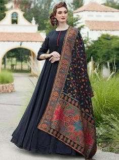 Magnificent black embroidered gown online at best shopping price. Shop this latest gown style for diwali celebration. This alluring style set comprises a silk gown with matching silk dupatta and crepe bottom.
