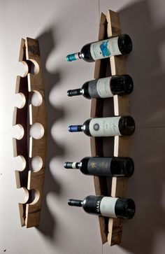 "Bordeaux Bottle Racks, built with the staves of old disused barrels... :) Porta bottiglie ""Bordeaux"" da parete realizzato con doghe di botte dismesse... Artigianato Made in Italy senza paragoni! http://woodulike.it/product/house/bordeaux-bottle-racks-model-arch/"