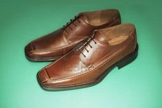 Men's brown leather dress shoes.