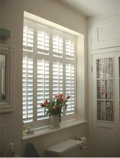 Inside mount shutters example in bathroom window                              …