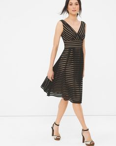 """This luxe dress is the perfect pick from work to cocktail hour. Complete with textured shadow stripes and a banded waist that creates a slim waistline—style it with chunky heels and chandelier earrings.   Sleeveless shadow stripe fit-and-flare dress  Fully lined   Polyester. Machine wash, cold.   Approx. 39"""" from shoulder   Imported"""