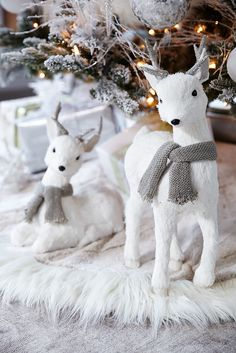 Snow-white faux fur, glass bead features and antlers covered in pewter-colored knit encrusted with silver paillettes combine to make Pier 1's Natural Reindeer the center of attention. With a coat that's been dusted in glitter and a matching scarf, it makes a captivating holiday statement displayed indoors alone or with a mate.