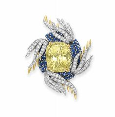 """Sapphire and diamond """"Wings"""" brooch by Jean Schlumberger, Tiffany & Co. Set with a cushion-cut yellow sapphire, weighing approximately 35.99 carats"""
