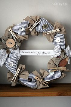 Idea to make it mine....in laundry room, with threaded needles in hearts, and as buttons get found in there pinned to the hearts till needed...maybe fill hearts with lavender, and use laundry room quote. Use single lost socks in the mix too, maybe cut into ribbon as the bows, or sewn into the hearts...