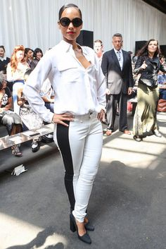 The 60 Best Celebrity Looks From Fashion Week Spring 2013: Kate Moss outfitted a slick leather trench with classic black trousers and pumps for her arrival at Mulberry in London.   : Alicia Keys punched up an all-white outfit at Edun with a bold black racing-stripe-style jean in NYC.