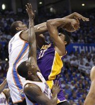 Oklahoma City Thunder forward Serge Ibaka, left, blocks a shot by Los Angeles Lakers center Andrew Bynum during the second quarter in Game 2 of an NBA basketball playoffs Western Conference semifinal, in Oklahoma City on Wednesday, May 16, 2012. Thunder wins it 77-75.