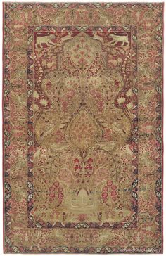 """Laver Kirman """"Tree of Life,"""" 4ft 6in x 7ft 0in, Circa 1850.  Fancifully rendered animal and bird motifs bring tremendous character to this collector's quality antique Persian Laver Kirman rug. A pair of lion's cubs playfully chase baby gazelles in the burgundy red upper spandrels, while a duo of geese roost in the foliage beneath the flowering """"Tree of Life"""" that dominates the rug's field. A series of individually drawn birds are partially hidden among the blossoming plants of its main…"""