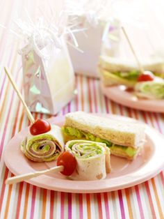 Make pinwheel sandwiches using ready-made crepes or tortilla bread (both available from supermarkets). Spread the crepes or tortilla breads with mashed avocado (mashed with a drizzle of lemon or lime juice) and reduced fat spreadable cream cheese. Roll up and cut into thick slices, secure with a halved cherry tomato and a cocktail fork and serve.