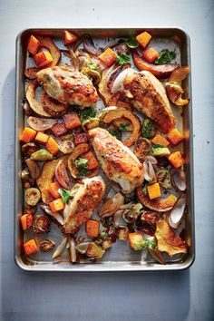 Maple-Mustard Roasted Chicken with Squash and Brussels Sprouts | We give the large bone-in breasts a head start in the oven so they will be perfectly cooked by the time the vegetables are done. This cut is also rather juicy; you'll want to drain off the liquid from the pan before adding the vegetables so they can caramelize evenly. Brussels sprouts, butternut squash, and acorn squash are at their absolute best when roasted. The trick is to cut them into even pieces with a maximum surface…