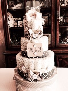 This shot of the diaper cake shows off it's yellow and gray colors Brittany Starzak