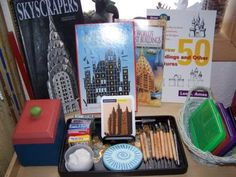 Activity trays with supplies and inspirational books, pics, etc. for different subjects