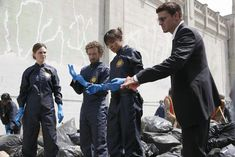Bones Season 2 - The Boy in the Shroud | Emily Deschanel as Dr. Temperance Brennan David Boreanaz as Special Agent Seeley Booth T.J. Thyne as Dr. Jack Hodgins Tamara Taylor as Dr. Camille Saroyan ©2006 Fox Broadcasting Co. Cr: Isabella Vosmikova/FOX