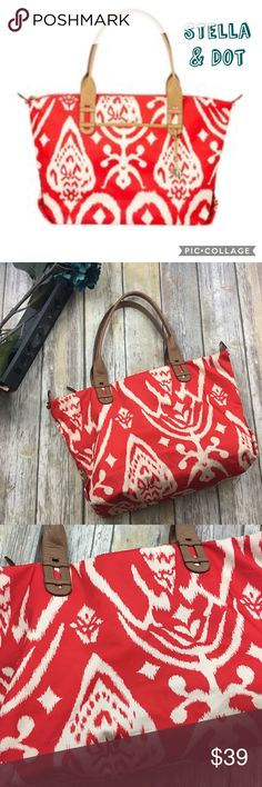 Stella & Dot La Totale Red/Orange & White Purse Red/orange and white design large purse. In excellent used condition. Zips closed. 3 pockets inside including one with a zipper. 1 pocket on the outside. 12 inch depth. 16 inch length. 6 inch width. Stella & Dot Bags Totes