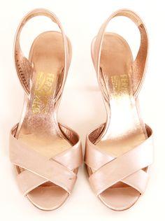A light champagne colored satin sling back sandal