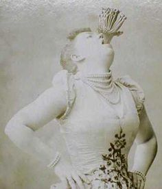Miss Victorina, sword swallower, with 10, count 'em, 10 swords