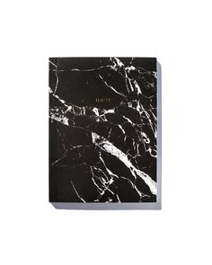 A beautifully designed, minimal paper notebook that opens to reveal crisp white blank pages. Uniquely designed &developed in-studio, this shattered black & white marble cover is one-of-a-kind. Fill your notes, ideas and more within its thick matted cover. From our Marble Line of THP Objects