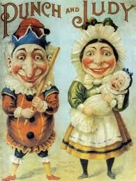 punch and judy -  What I love is the creepy joy and expectation on their faces--- joy, but not quite!  Rosy cheeks, red lips, a huge batton in his hand.