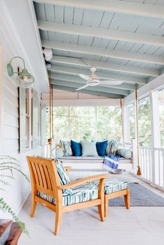 A schoolhouse wall sconce adds vintage style to this screened porch. American made schoolhouse lighting is easy to customize at Barn Light Electric. Free ship!