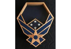 FREE Priority Shipping!! This Air Force Shadow Box is handcrafted from solid oak. Protect and display your medals, patches, rank, coins, and flag from your many years of service. Display area background fabric is blue suede cloth. Glass is double strength. You will very easily access the display