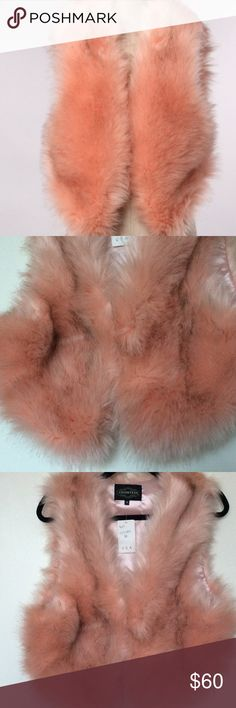 HP-1/25Cotton Candy Pink Faux Fur Vest Soft and fluffy pink faux fur vest with brown highlights, hook and eye closure. 70% Acrylic 30% Polyester Countess Jackets & Coats Vests