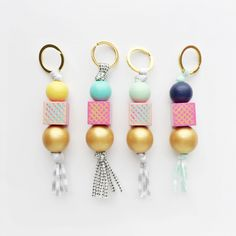 MON AMIE modern handpainted keychain, wood bead keychain, tassel keychain, zipper pull, wooden bead zipper pull by coralandcloud on Etsy https://www.etsy.com/listing/399674629/mon-amie-modern-handpainted-keychain