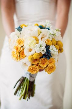 Danni - can you find out what these blue berries are called?  They look great in this bouquet.