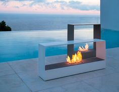 Llar | Borja Garcia Studio #bioetanol #chimney  #metal #colors #outdoor #pool #white #light #architecture #fire #design