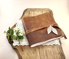A personal favorite from my Etsy shop https://www.etsy.com/listing/543887465/personalized-leather-wedding-guest-book
