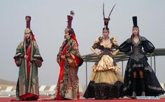 Models present traditional costumes of the Mongolian ethnic group during a fashion show at the Xiangshawan (resonant sands bay) Tourism P...