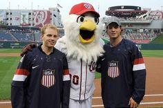 WASHINGTON, DC - AUGUST 27:  Hockey players Patrick Kane and John Carlson pose with Nationals mascot Screech before the game between the Washington Nationals and the Miami Marlins at Nationals Park on August 27, 2013 in Washington, DC.