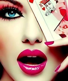 love the makeup... and eye covered by playing card... maybe red queen rather than a king...
