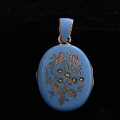 A beautiful shade of blue enamel makes this Victorian locket stand out.