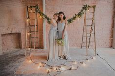 Festoon lights | Vintage Step Ladders | Bridesmaid Dresses By Caroline Campion | Industrial & Botanical Wedding Inspiration | Exposed Brick | Greenery | Candlesticks | Image by Susannah Blatchford Photography | http://www.rockmywedding.co.uk/bridesmaids-dresses-by-caroline-campion/