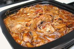 Smothered Pork Chops - I made a few changes to make this a perfect dish.  Use beef broth instead of chicken.  Use medallions from a pork tenderloin instead of chops.  Add red or white wine after sauteeing the onions & mushrooms and let reduce by half.