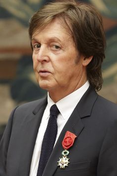 Paul McCartney during a decoration ceremony photo session at the Elysee Palace