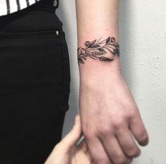 Botanical bracelet tattoo by Vlada Shevchenko