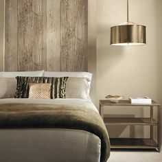 Faux wood wallpaper as a headboard. bedroom wallpaper. Wooden wall look. #outdoorsinside #nature