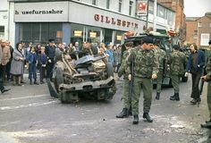 British troops prepare to move an overturned and wrecked car, used as a barricade in Newtownwards Road in Belfast, capital of Northern Ireland in May 1974, during the strike called by members of the Ulster Workers Council. (AP Photo) Ref #: PA.10990748