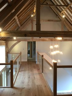 Glazed bridge leading to master bedroom from office. Feature-Glazed bridge leading to master bedroom from office. Va Glazed bridge leading to master bedroom from office. Farmhouse Master Bedroom, Home Bedroom, Bedroom Ideas, Barn Conversion Interiors, Barn Conversion Bedroom, Barn House Conversion, Barn Conversions, Chandelier Design, Chandelier Bedroom
