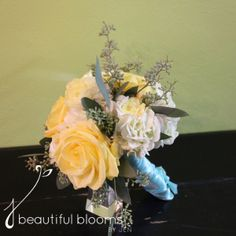 White and yellow bridesmaid's bouquet by Beautiful Blooms by Jen. Hydrangea, ranunculus and roses