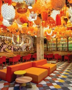 The Design Agency's Generator Hostel in Barcelona offers a tapestry of layers and styles that provides an unforgettable hospitality experience for its guests. Hungarian concrete floor tiles anchor the lobby and rear bar area designed to encourage social interaction and mingling. Over 300 lanterns by local artist Julie Plottier inspired by Barcelona's vibrant energy and sunlight float overhead. #architecture #interiors #design #interiordesign #hostel #barcelona... - Interior Design Ideas…
