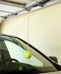 Tennis ball hanging in garage to use as a guide when parking!
