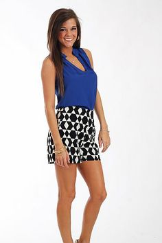 """Every girl NEEDS these shorts in her closet! The black and white scheme is a timeless choice and we love the geometric patterns and high waistline on these shorts. Tuck in a tank or wear it loose... these shorts are a great pick no matter what!   Fits true to size. Miranda is wearing a small.   From waistband to hemline:  Small - 14""""  Medium - 14.5""""  Large - 15""""   Inseam:  Small - 3""""  Medium - 3.25""""  Large - 3.5"""""""