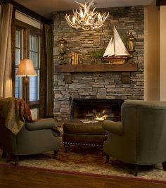 A stone fireplace with a rough-hewn mantle light up this room with ...