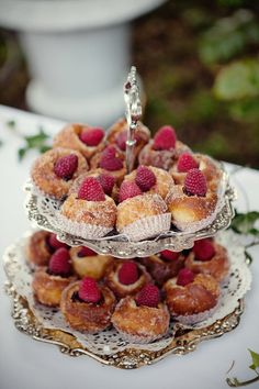 Ok, I couldn't get to the recipe so I'm thinking - fried donut batter, rolled in sugar, hollowed out, filled with ganche and topped w/ a raspberry?